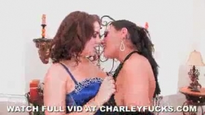 Charley Chase and Exquisite Kitty are licking each other's pussy, while in a huge bed